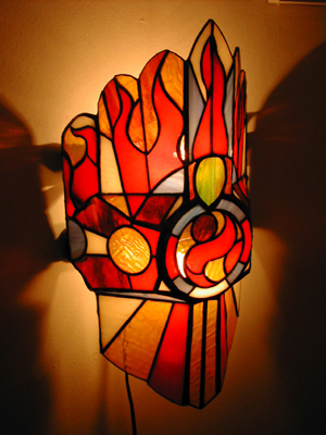 Fire Lamp_Stained Glass I designed and built this lamp on a wood form I made.Using copper foil and glass. It is based on the concept of a shield.